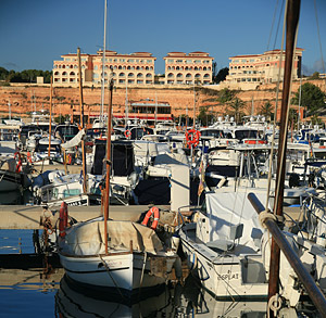 The Port Adriano hotel looks out over the small harbour of the same name